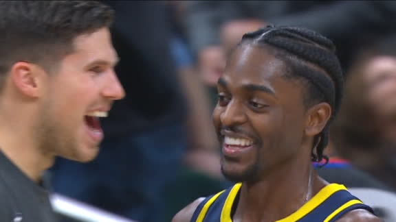 Justin Holiday's late 3 gets Pacers bench on their feet