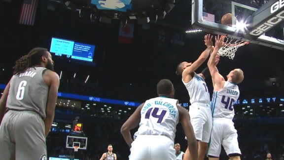 Martin and Zeller tip in bucket on their own hoop