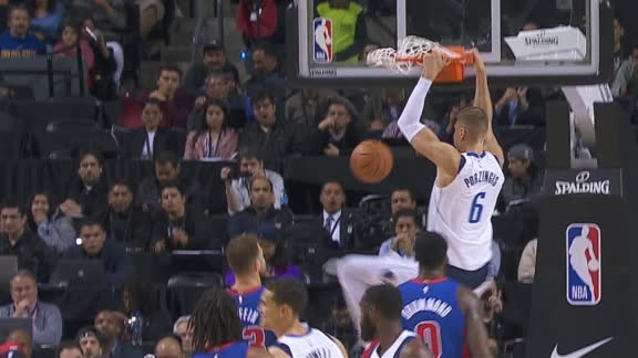Doncic tosses alley-oop to Porzingis