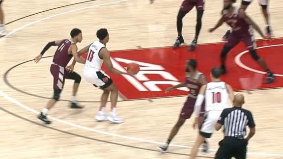 Johnson's no-look dime sets up Louisville triple