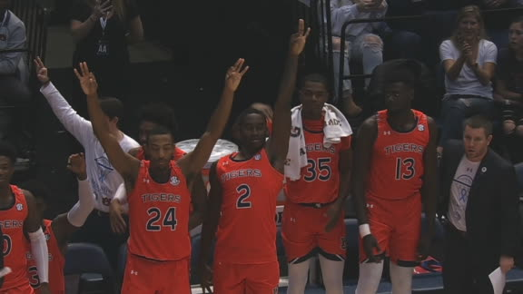 Johnson's 3 gets Auburn's bench on its feet