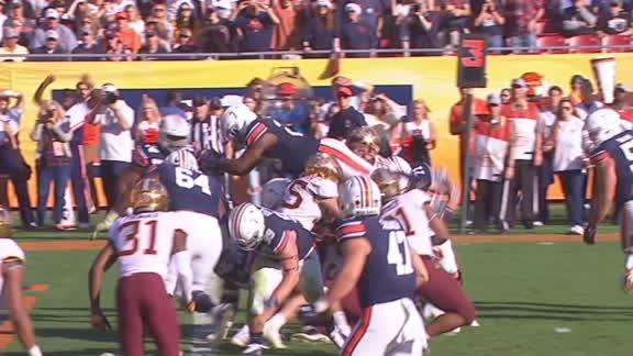 Whitlow files over the pile for a TD