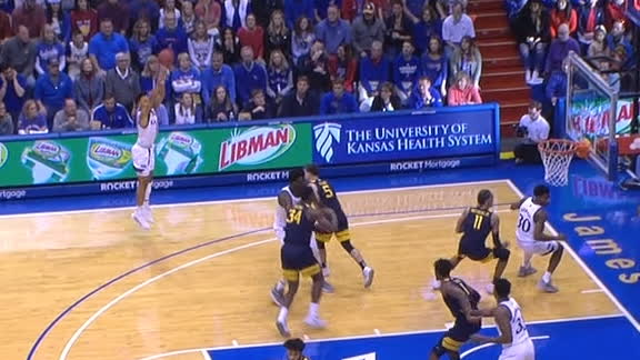 Kansas' Dotson swishes the trey from way downtown