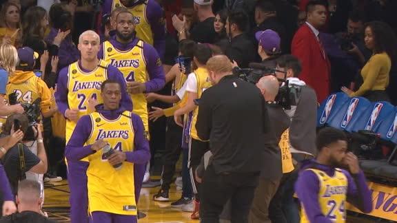 Lakers don Kobe jerseys during pregame warm-ups