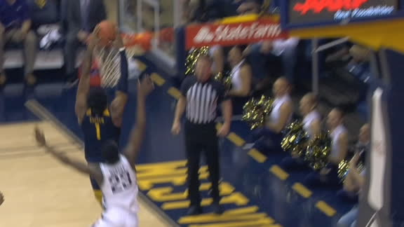 WVU's Haley feeds Culver for the jam