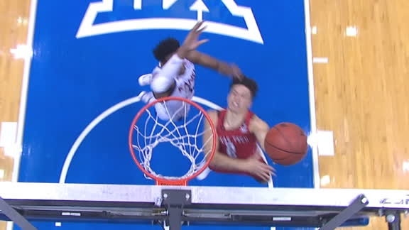 KU's McCormack stuffs opponent at rim