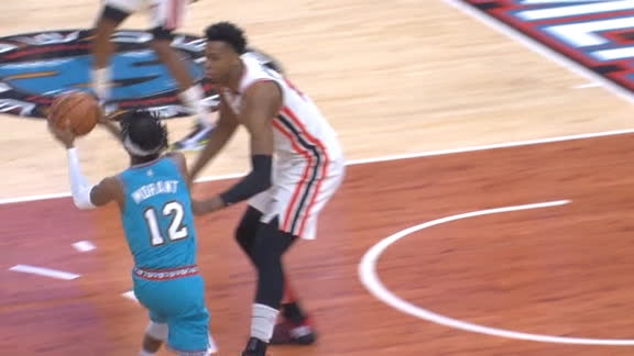 Morant uses the fake pass to set up the layup