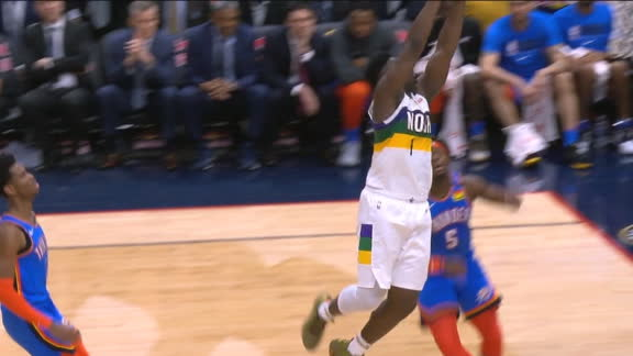 Zion hop steps and slams home fast-break dunk