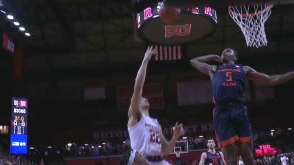 Illinois' Jones swats the ball off glass