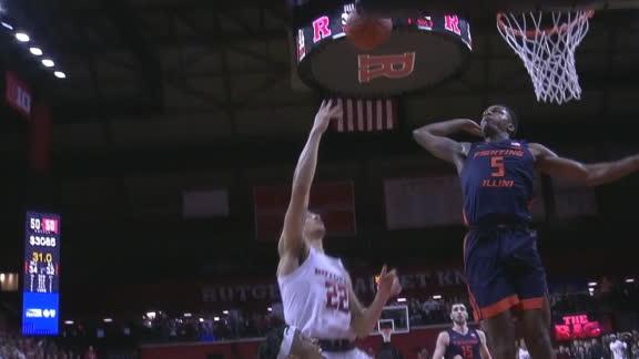 Illinois' Jones swats the ball off glass