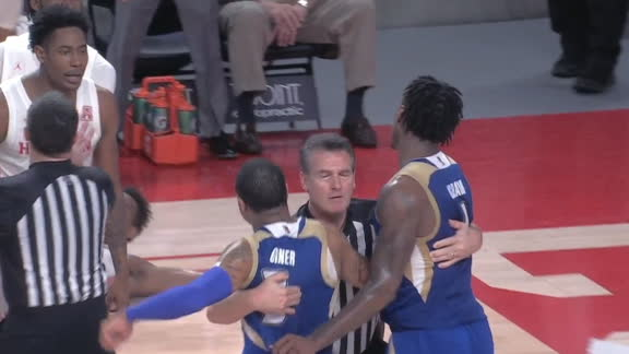 Referee holds back two Tulsa players to avoid scuffle