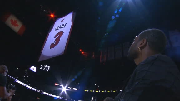 Wade watches No. 3 rise to Heat rafters