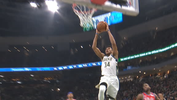 Giannis gets out in transition for the slam