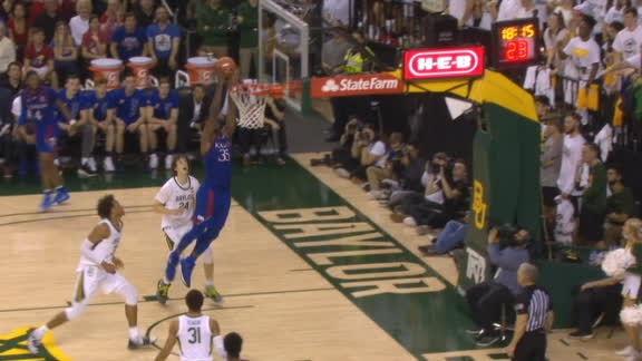 Kansas' Garrett feeds Azubuike for the jam