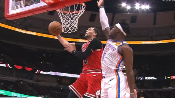 Lavine goes under and around the rim for slam