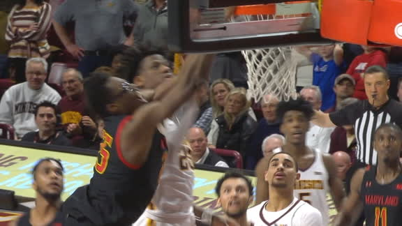 Smith crashes the board and scores on the tip-dunk for Maryland