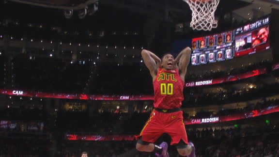 Teague flashes a smile while throwing down the dunk