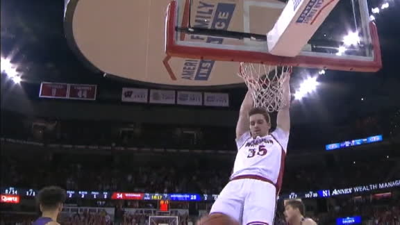 Reuvers flushes home a Badgers dunk
