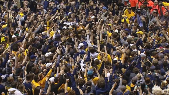 WVU fans storm the court after No. 4 Baylor goes down