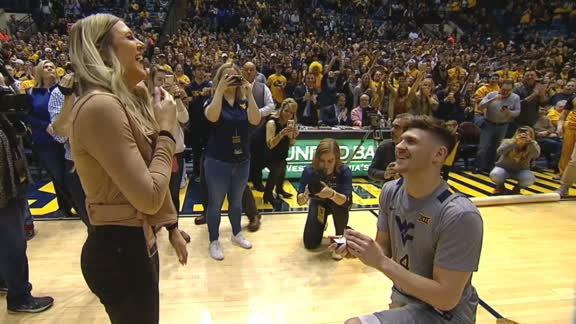 West Virginia's Chase Harler proposes during Senior Day