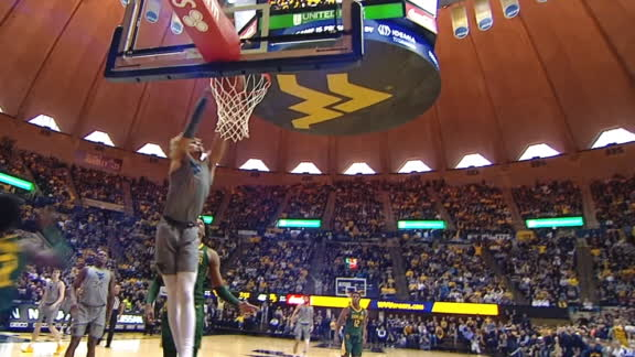 Matthews increases WVU's lead with a dunk