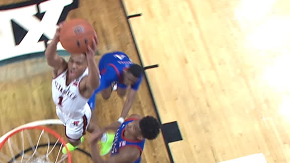 Texas Tech's Shannon weaves around defender for the dunk