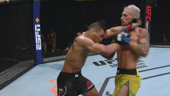 Oliveira lands a series of uppercuts against Lee