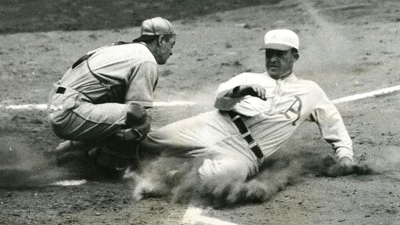Cardinals catcher Jimmie Wilson tags out A's outfielder Al Simmons during the second inning of Game 5 of the 1931 World Series.