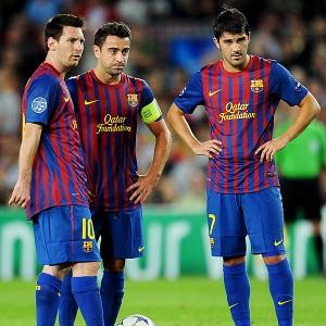 Lionel Messi (L), Xavi Hernandez (C) and David Villa