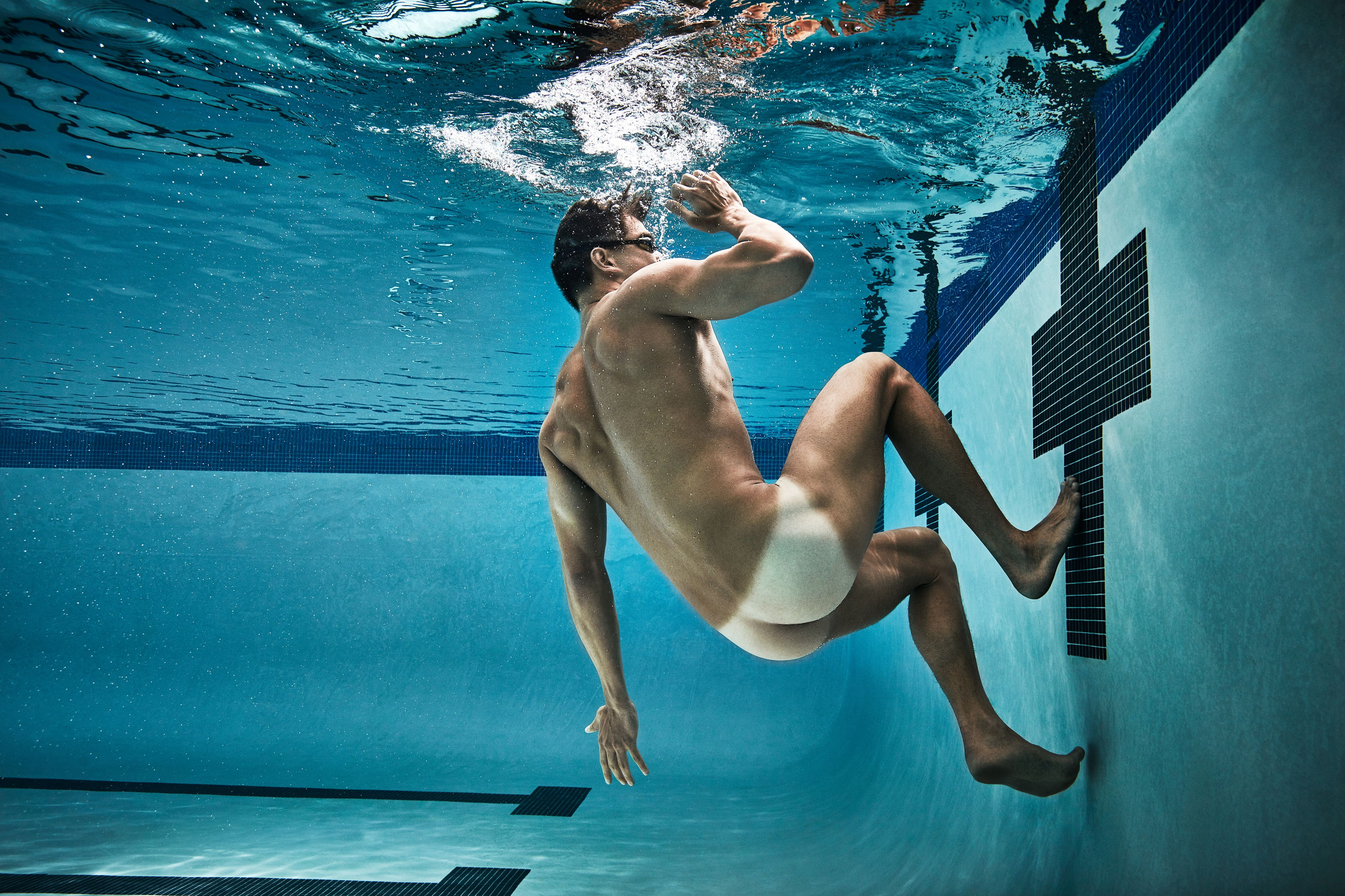 Nude athletic guy in the pool