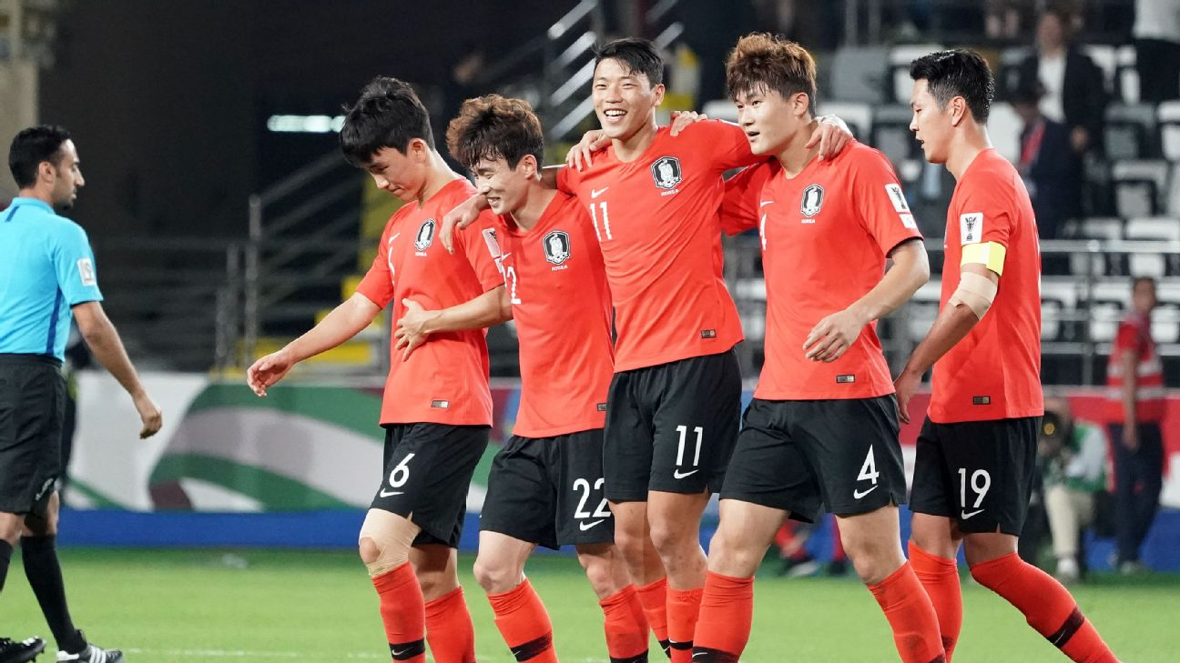 South Korea players celebrate after scoring a goal against China in the Asian Cup.