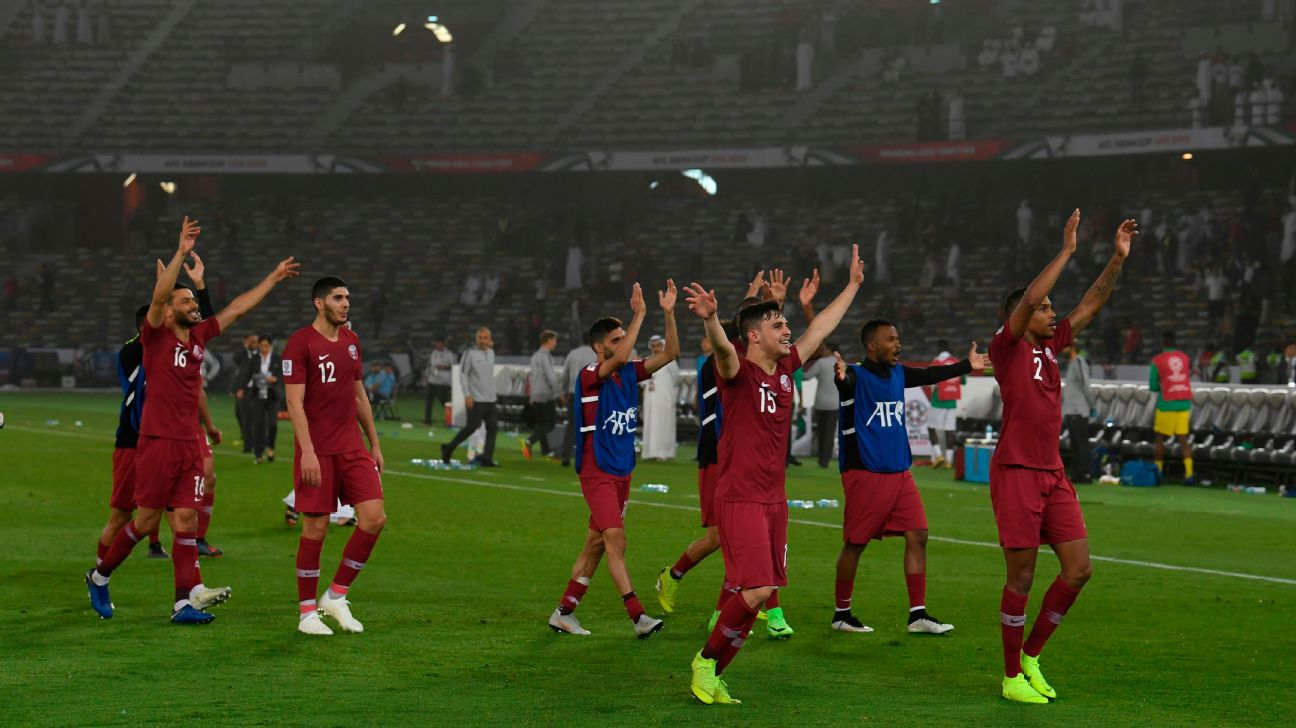Qatar players celebrate after beating Saudi Arabia in the Asian Cup to win Group E.
