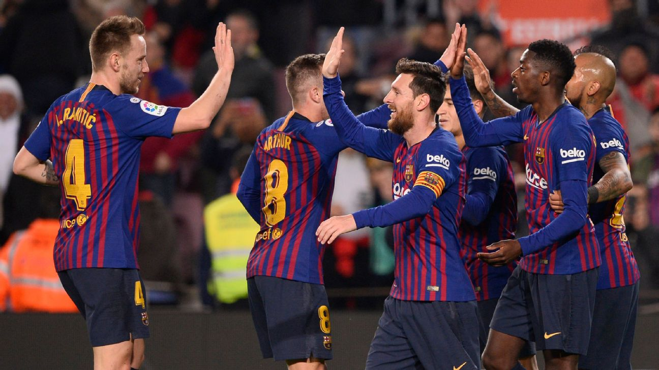 Barcelona players celebrate after scoring a goal against Levante in the Copa del Rey.