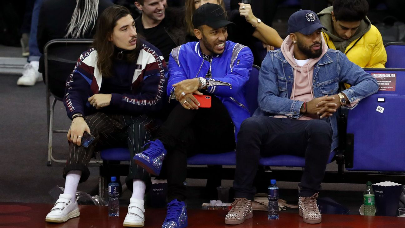 Hector Bellerin, Pierre-Emerick Aubameyang and Alexandre Lacazette of Arsenal watch the NBA London Game 2019