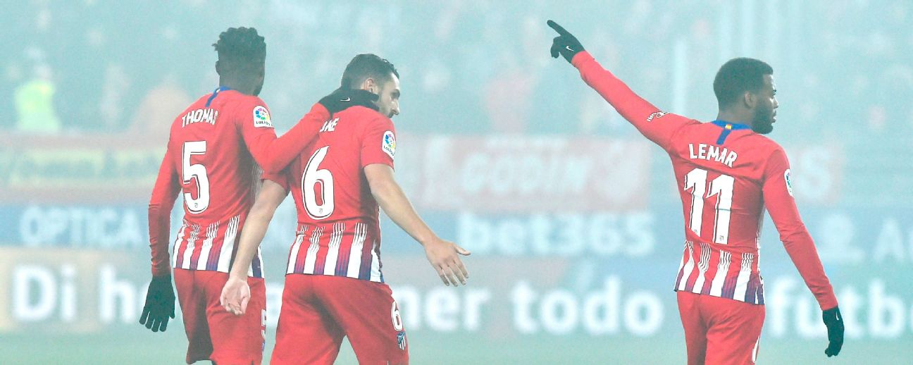 Atletico Madrid bounce back with easy win over Huesca in La Liga