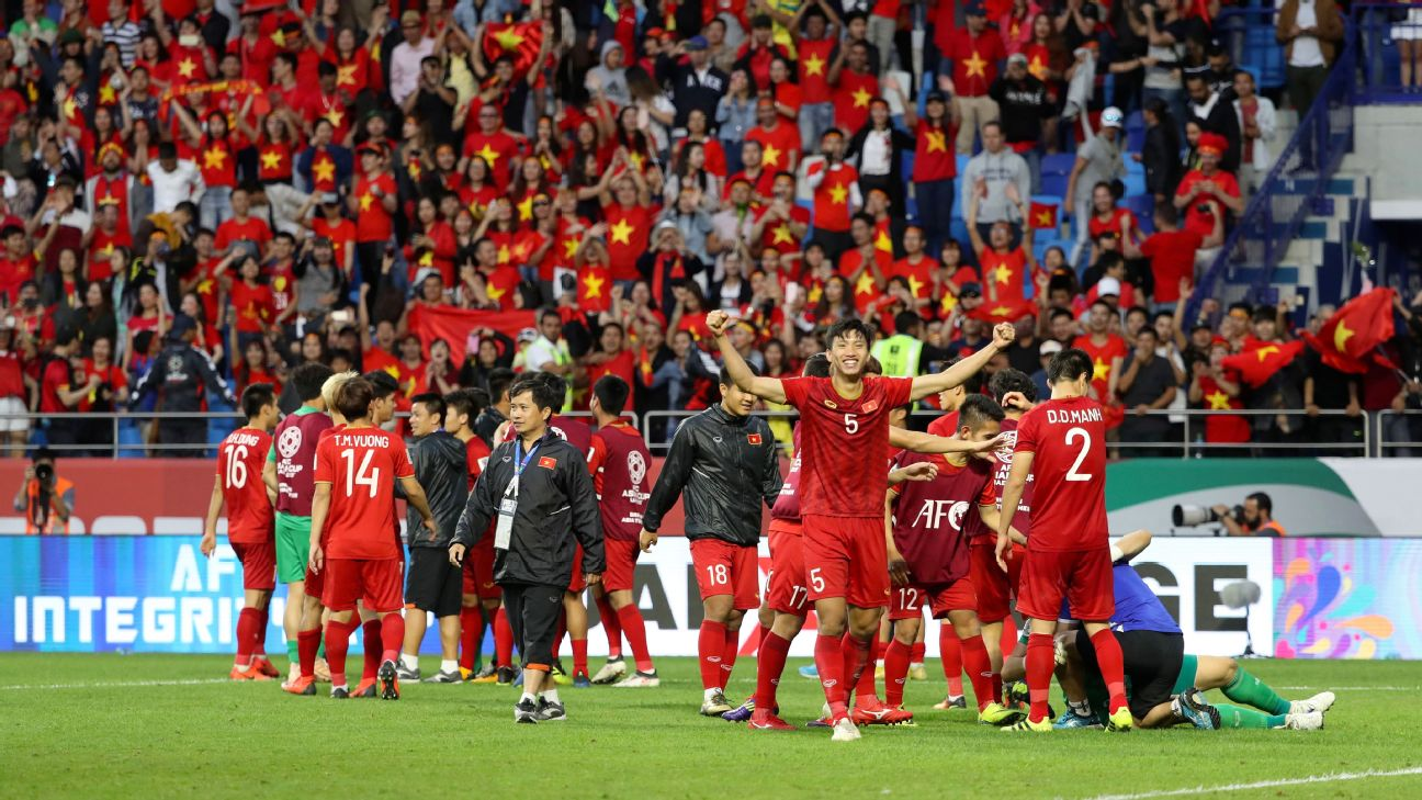 Vietnam players celebrate their penalty shootout win over Jordan in the Asian Cup.