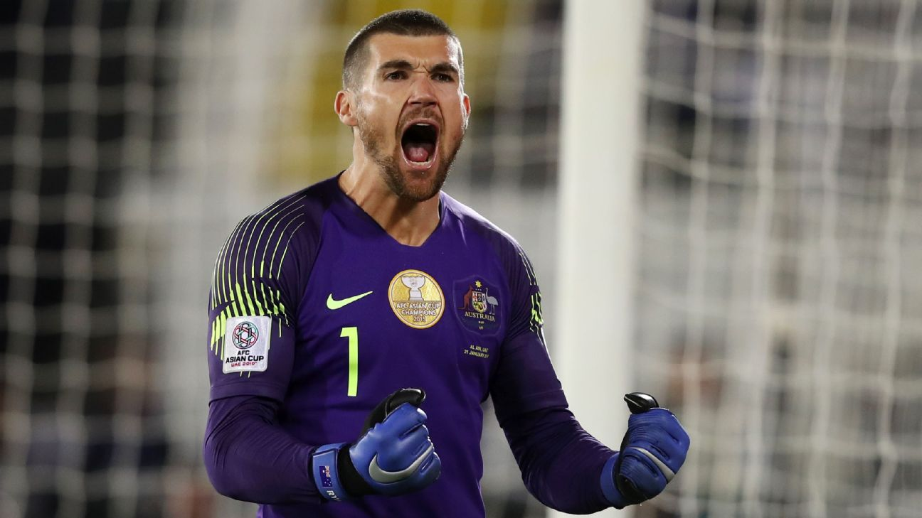 Mat Ryan celebrates after Australia's Asian Cup win over Uzbekistan.