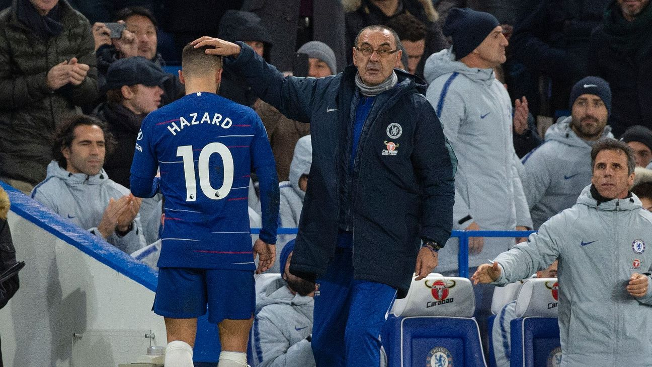 Chelsea manager Maurizio Sarri, right, pats midfielder Eden Hazard on the head as he leaves the pitch against Man City.