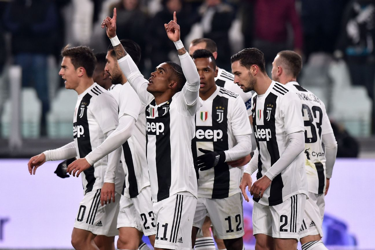 Douglas Costa, centre, celebrates with Juventus teammates after scoring a goal against Chievo.