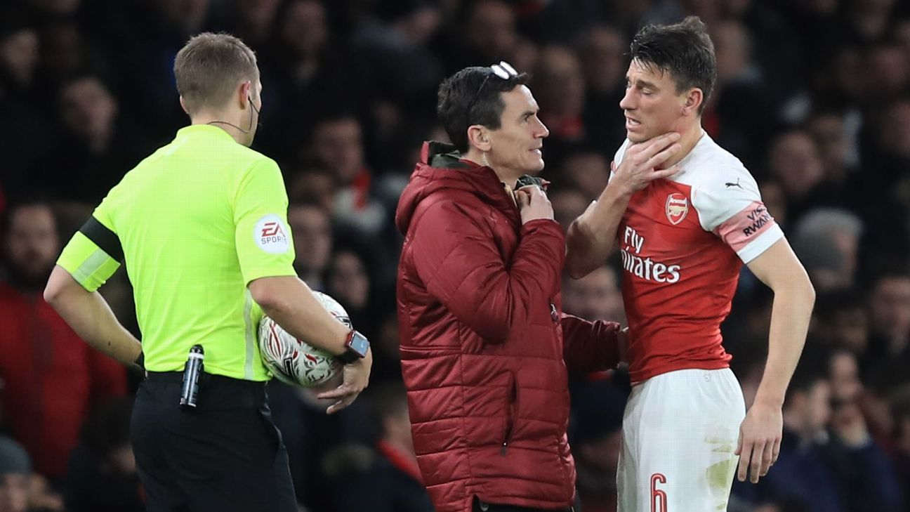 An Arsenal team medic tends to Laurent Koscielny after he sustained an injury against Manchester United in the FA Cup.