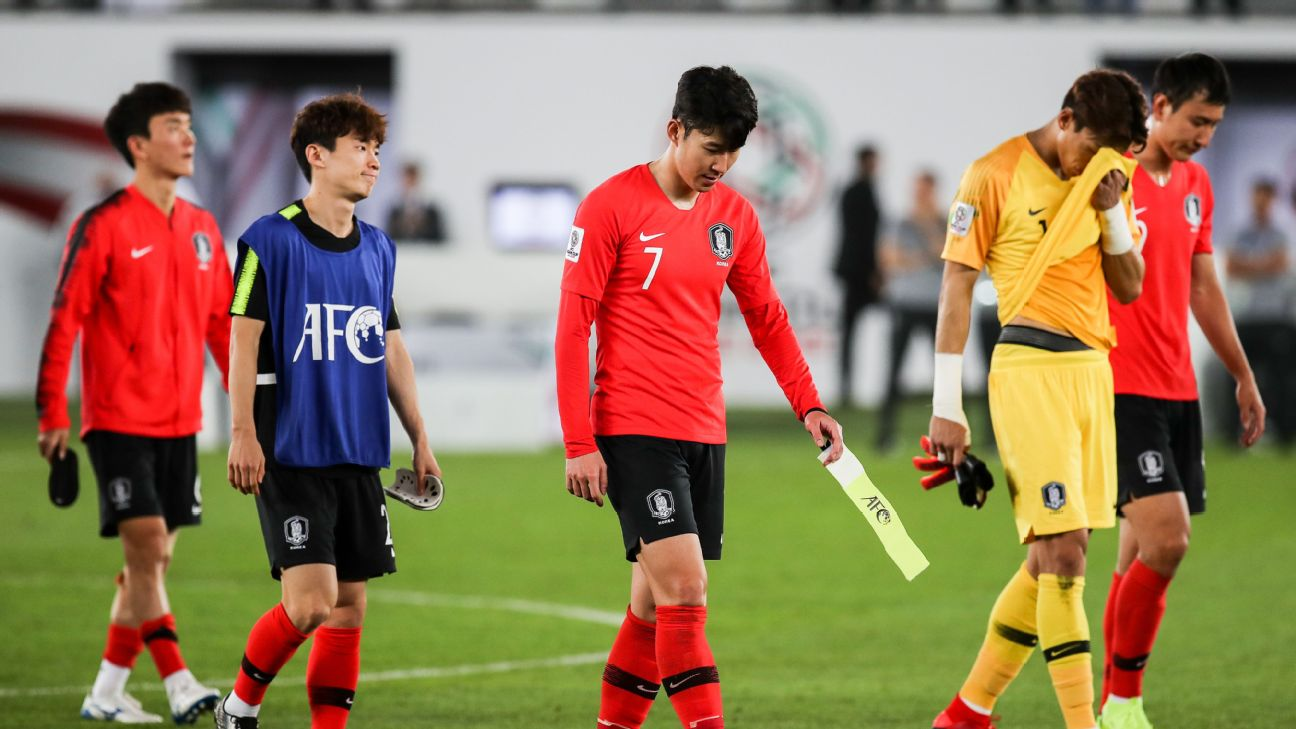 Son Heung-min leaves the pitch with teammates after South Korea's loss to Qatar at the Asian Cup.