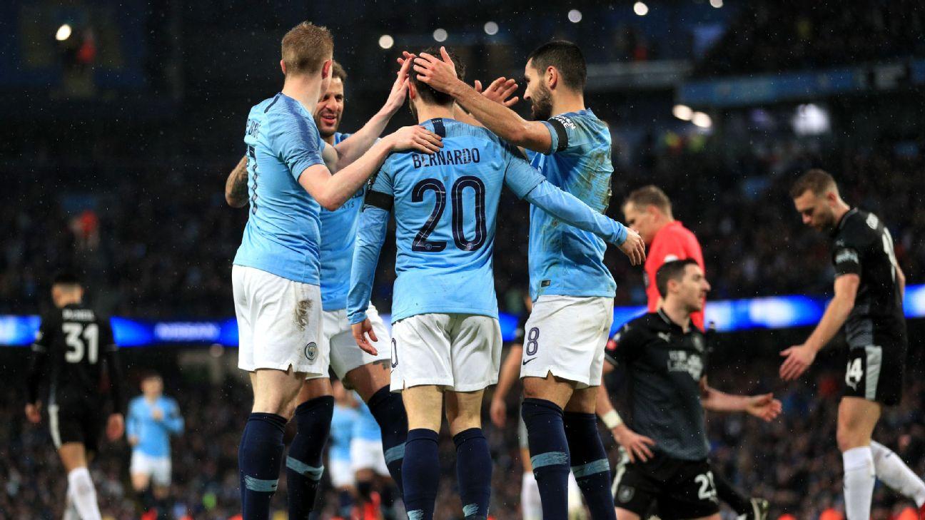 Bernardo Silva of Manchester City celebrates with teammates after scoring his team's second goal