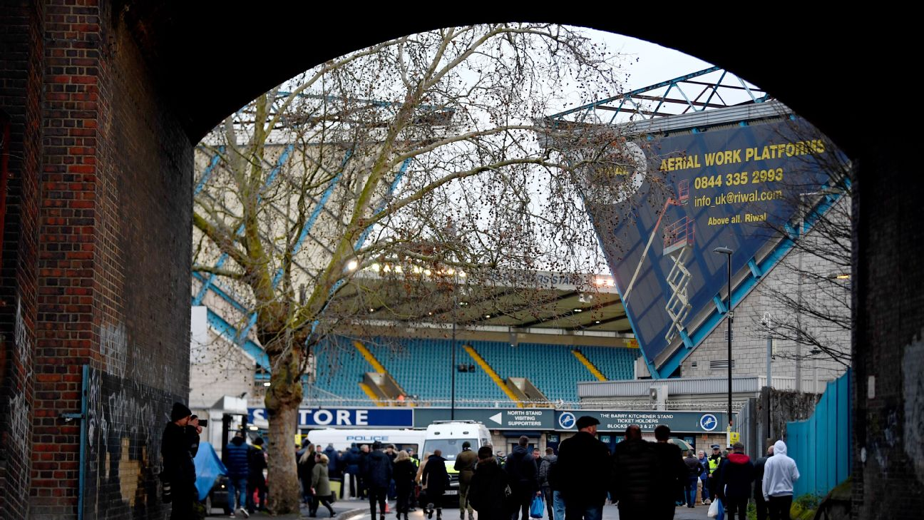 Fans walk into The Den in London ahead of Millwall's FA Cup match against Everton.