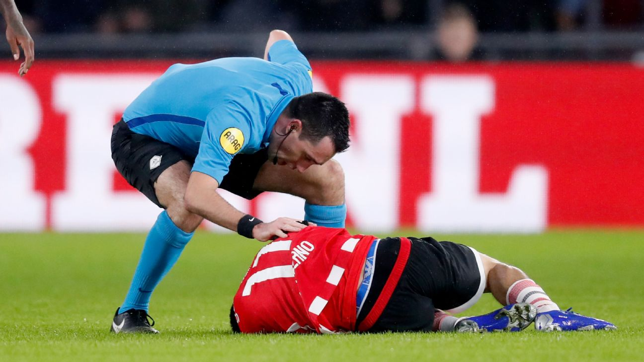 PSV forward Hirving Lozano lies on the ground after sustaining an injury against Groningen.