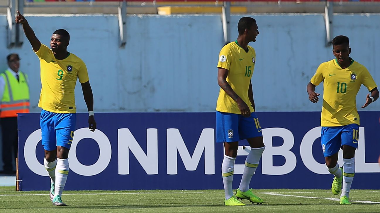Brazil's Lincoln, left, celebrates after scoring a goal at the South American U20 Championships.