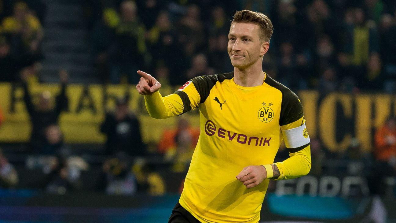 Marco Reus celebrates after scoring in Borussia Dortmund's Bundesliga win over Hannover.