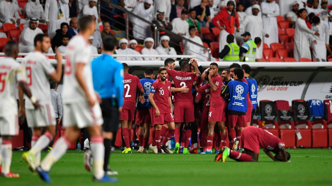 Qatar's players celebrate their opening goal during the 2019 AFC Asian Cup semi-final football match between Qatar and UAE