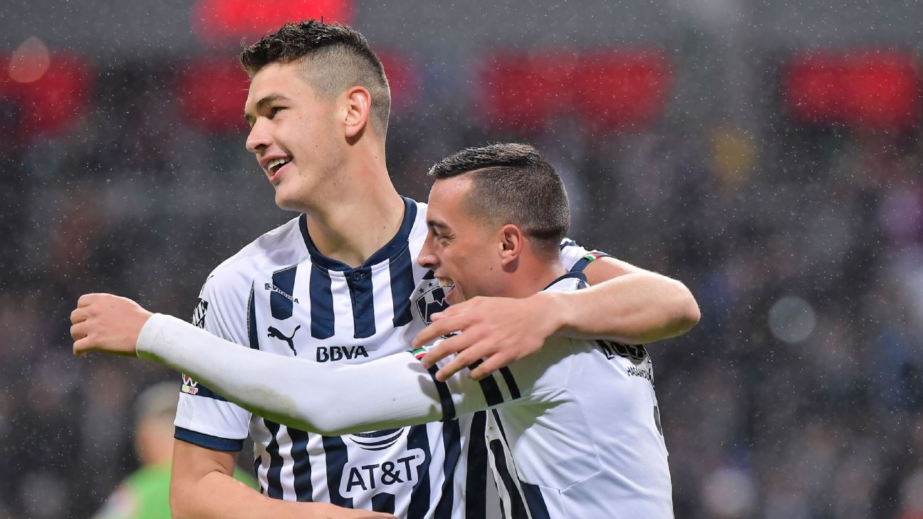 Cesar Montes and Rogelio Funes Mori celebrate during Monterrey's Liga MX win over America.