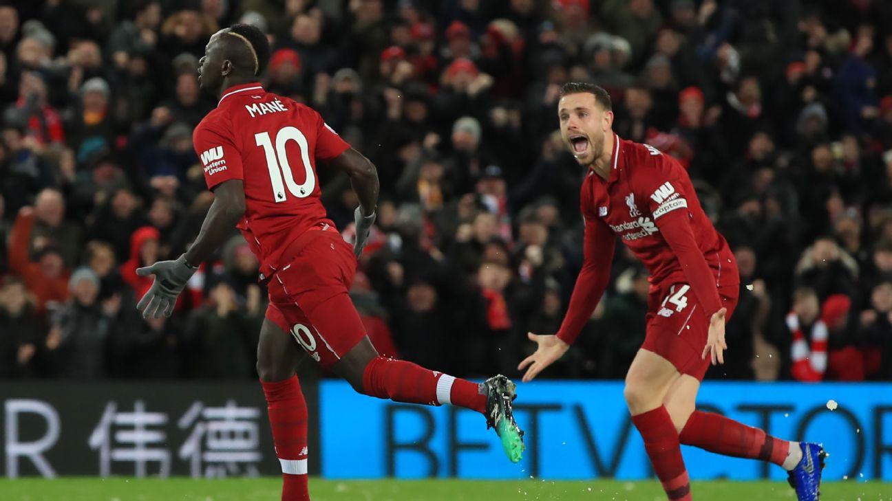 Sadio Mane, left, celebrates after scoring in Liverpool's Premier League match against Leicester City.