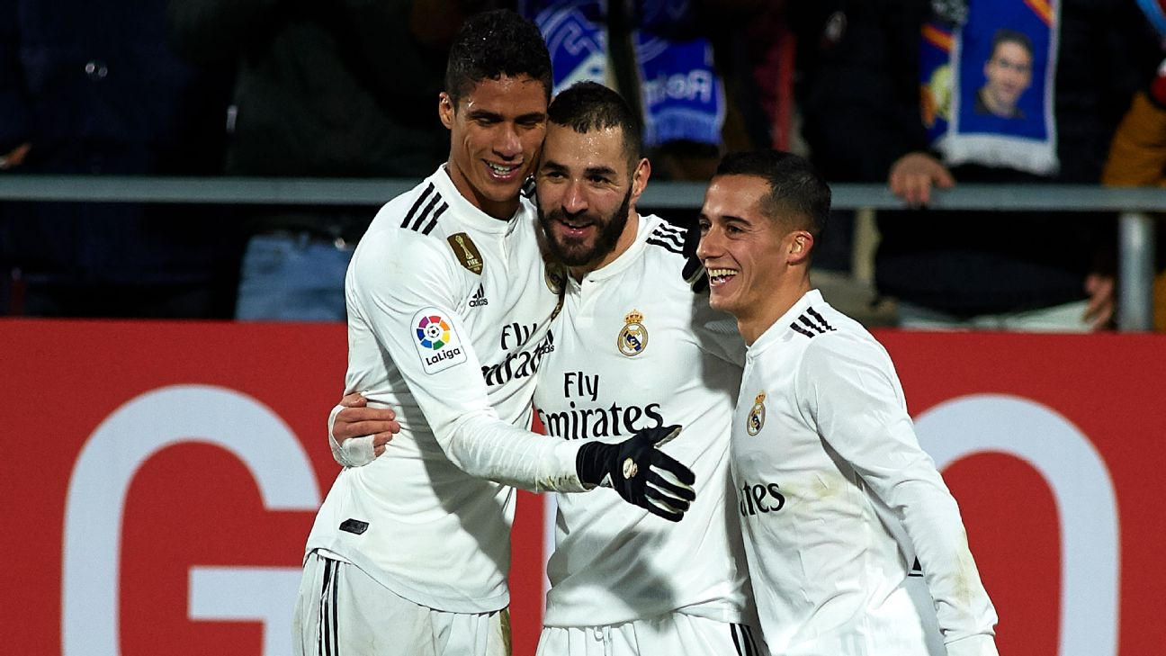 Real Madrid players celebrate after a Karim Benzema goal in the Copa del Rey against Girona.